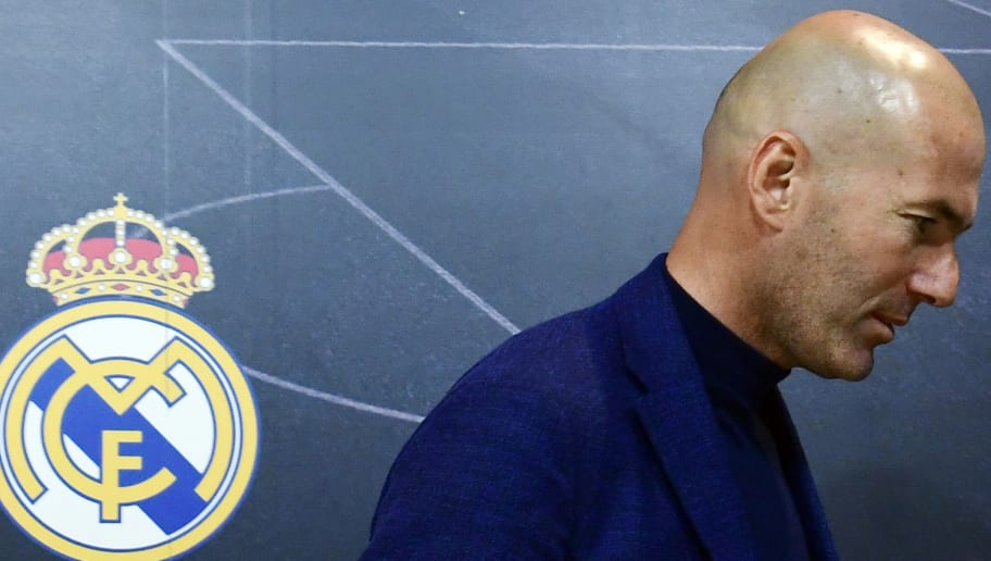 TOPSHOT - Real Madrid's French coach Zinedine Zidane leaves after announcing his resignation in Madrid on May 31, 2018. - Real Madrid coach Zinedine Zidane said today he was leaving the Spanish giants in a surprise move announced just days after winning the Champions League for the third year in a row. (Photo by PIERRE-PHILIPPE MARCOU / AFP)        (Photo credit should read PIERRE-PHILIPPE MARCOU/AFP/Getty Images)