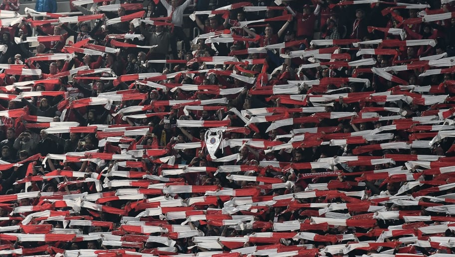 TOPSHOT - Bayern Munchen's fan brandish scarfs before the UEFA Champions League football match between AEK Athens FC and FC Bayern Munchen at the OACA Spyros Louis stadium in Athens on October 23, 2018. (Photo by ARIS MESSINIS / AFP)        (Photo credit should read ARIS MESSINIS/AFP/Getty Images)