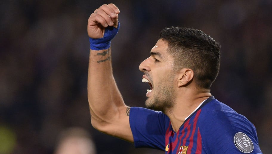 TOPSHOT - Barcelona's Uruguayan forward Luis Suarez reacts during the UEFA Champions League group B match Barcelona against Inter Milan at the Camp Nou stadium in Barcelona on October 24, 2018. (Photo by Josep LAGO / AFP)        (Photo credit should read JOSEP LAGO/AFP/Getty Images)