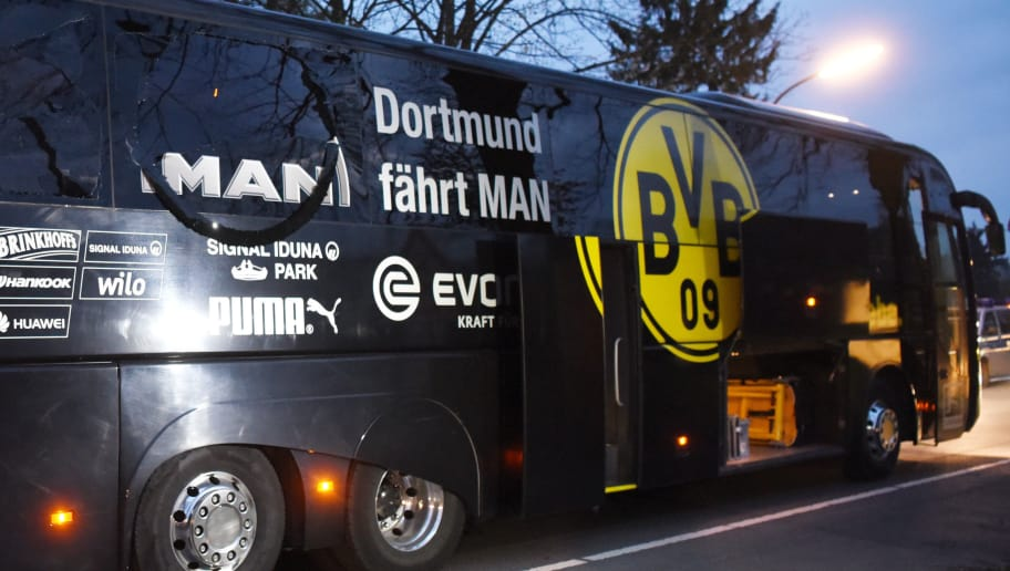 TOPSHOT - Borussia Dortmund's damaged bus is pictured after an explosion some 10km away from the stadium prior to the UEFA Champions League 1st leg quarter-final football match BVB Borussia Dortmund v Monaco in Dortmund, western Germany on April 11, 2017. / AFP PHOTO / Patrik STOLLARZ        (Photo credit should read PATRIK STOLLARZ/AFP/Getty Images)