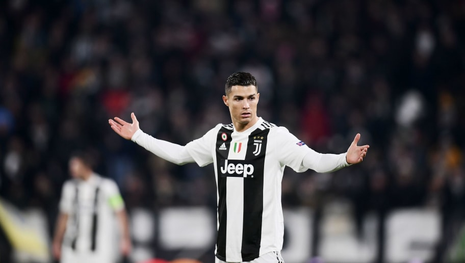 TOPSHOT - Juventus' Portuguese forward Cristiano Ronaldo reacts during the UEFA Champions League group H football match Juventus vs Valence on November 27, 2018 at the Juventus stadium in Turin. (Photo by Marco BERTORELLO / AFP)        (Photo credit should read MARCO BERTORELLO/AFP/Getty Images)