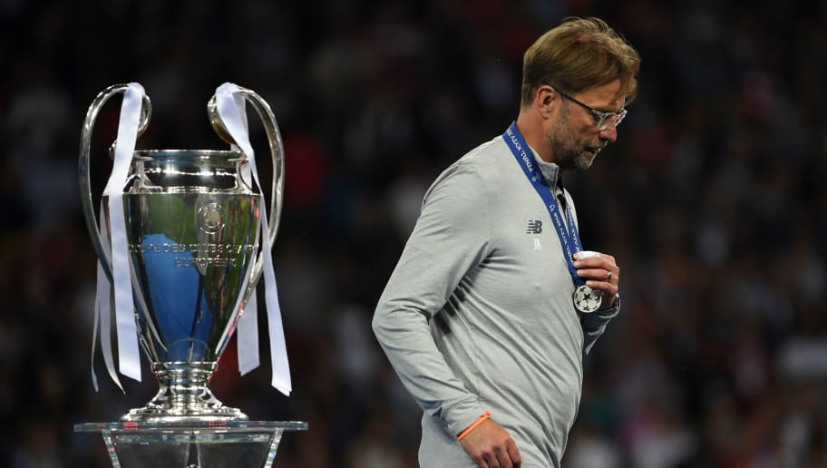 TOPSHOT - Liverpool's German manager Jurgen Klopp walks past the trophy as he collects his loser's medal after the UEFA Champions League final football match between Liverpool and Real Madrid at the Olympic Stadium in Kiev, Ukraine on May 26, 2018. - Real Madrid defeated Liverpool 3-1. (Photo by Paul ELLIS / AFP)        (Photo credit should read PAUL ELLIS/AFP/Getty Images)