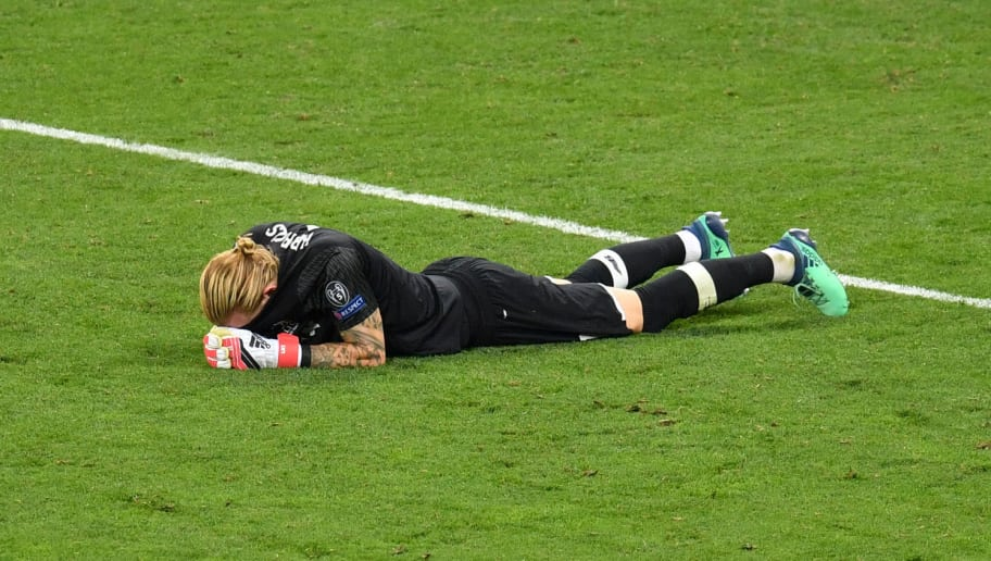 TOPSHOT - Liverpool's German goalkeeper Loris Karius lays on the pitch after the UEFA Champions League final football match between Liverpool and Real Madrid at the Olympic Stadium in Kiev, Ukraine on May 26, 2018 (Photo by Sergei SUPINSKY / AFP)        (Photo credit should read SERGEI SUPINSKY/AFP/Getty Images)