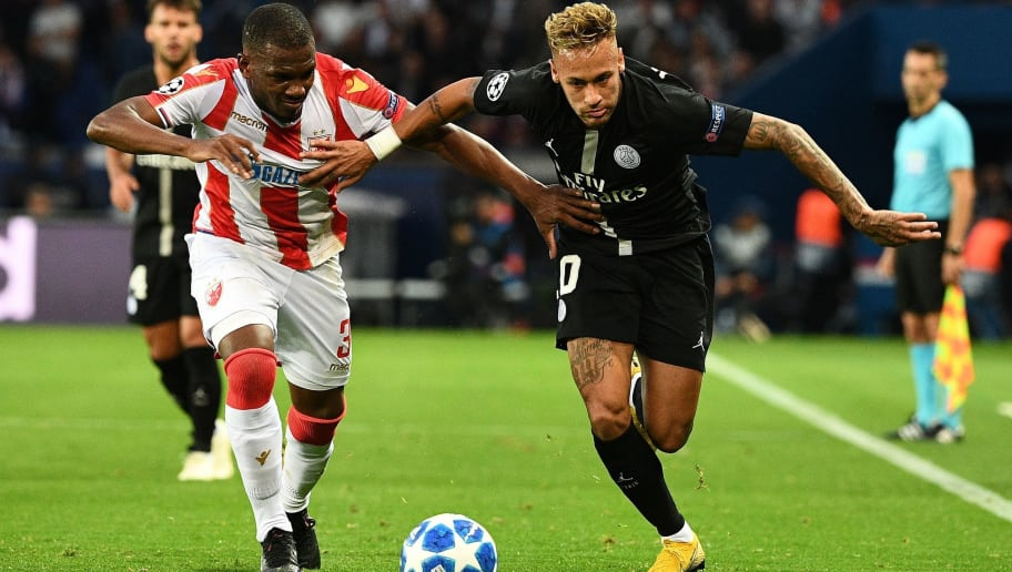 TOPSHOT - Paris Saint-Germain's Brazilian forward Neymar (R) fights for the ball with Red Star Belgrade's defender Branko Jovicic during the UEFA Champions' League football match Paris Saint Germain (PSG) against Red Star Belgrade at the Parc des Princes stadium in Paris on October 3, 2018. (Photo by FRANCK FIFE / AFP)        (Photo credit should read FRANCK FIFE/AFP/Getty Images)