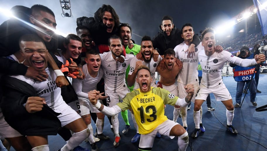 TOPSHOT - Paris Saint-Germain's Brazilian forward Neymar (front), wearing the jersey of Liverpool's Brazilian goalkeeper Alisson Becker, celebrates with teammates after their 2-1 win of the UEFA Champions League Group C football match between Paris Saint-Germain (PSG) and Liverpool FC at the Parc des Princes Stadium, in Paris, on November 28, 2018. (Photo by FRANCK FIFE / AFP)        (Photo credit should read FRANCK FIFE/AFP/Getty Images)