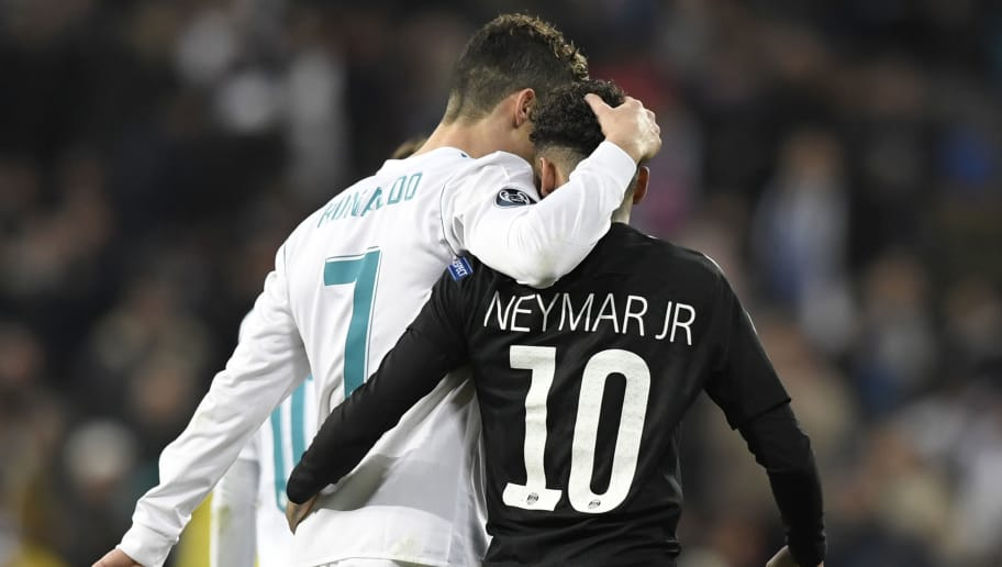 TOPSHOT - Real Madrid's Portuguese forward Cristiano Ronaldo (L) and Paris Saint-Germain's Brazilian forward Neymar leave the pitch at half-time during the UEFA Champions League round of sixteen first leg football match Real Madrid CF against Paris Saint-Germain (PSG) at the Santiago Bernabeu stadium in Madrid on February 14, 2018.   / AFP PHOTO / GABRIEL BOUYS        (Photo credit should read GABRIEL BOUYS/AFP/Getty Images)