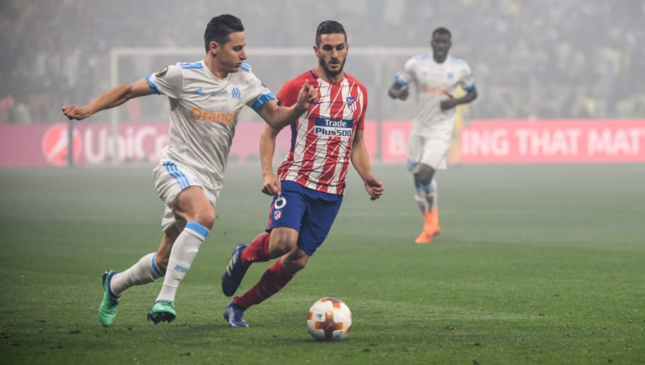 TOPSHOT - Marseille's French midfielder Florian Thauvin (L) vies with Atletico Madrid's Spanish midfielder Koke during the UEFA Europa League final football match between Olympique de Marseille and Club Atletico de Madrid at the Parc OL stadium in Decines-Charpieu, near Lyon on May 16, 2018. (Photo by Philippe DESMAZES / AFP)        (Photo credit should read PHILIPPE DESMAZES/AFP/Getty Images)