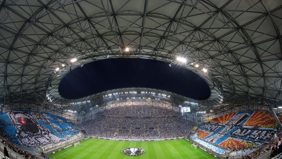 TOPSHOT - A picture taken with a fisheye lens on April 26, 2018 shows spectators watching the ceremony ahead of the UEFA Europa League first-leg semi-final football match between Olympique de Marseille and FC Salzburg at the Velodrome Stadium in Marseille, southeastern France. (Photo by Emmanuel BARRANGUET / AFP)        (Photo credit should read EMMANUEL BARRANGUET/AFP/Getty Images)