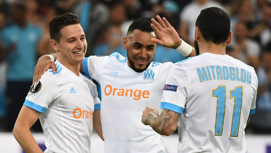 TOPSHOT - Marseille's French midfielder Florian Thauvin (L) celebrates with Marseille's French forward Dimitri Payet (C) and Marseille's Greek forward Konstantinos Mitroglou after scoring a goal during the UEFA Europa League first-leg semi-final football match between Olympique de Marseille and FC Salzburg at the Velodrome Stadium in Marseille, southeastern France, on April 26, 2018. (Photo by Boris HORVAT / AFP)        (Photo credit should read BORIS HORVAT/AFP/Getty Images)