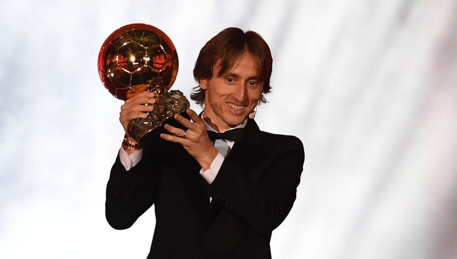TOPSHOT - Real Madrid's Croatian midfielder Luka Modric kisses the trophy after receiving the 2018  Men's Ballon d'Or award for best player of the year during the 2018  Ballon d'Or award ceremony at the Grand Palais in Paris on December 3, 2018. (Photo by FRANCK FIFE / AFP)        (Photo credit should read FRANCK FIFE/AFP/Getty Images)