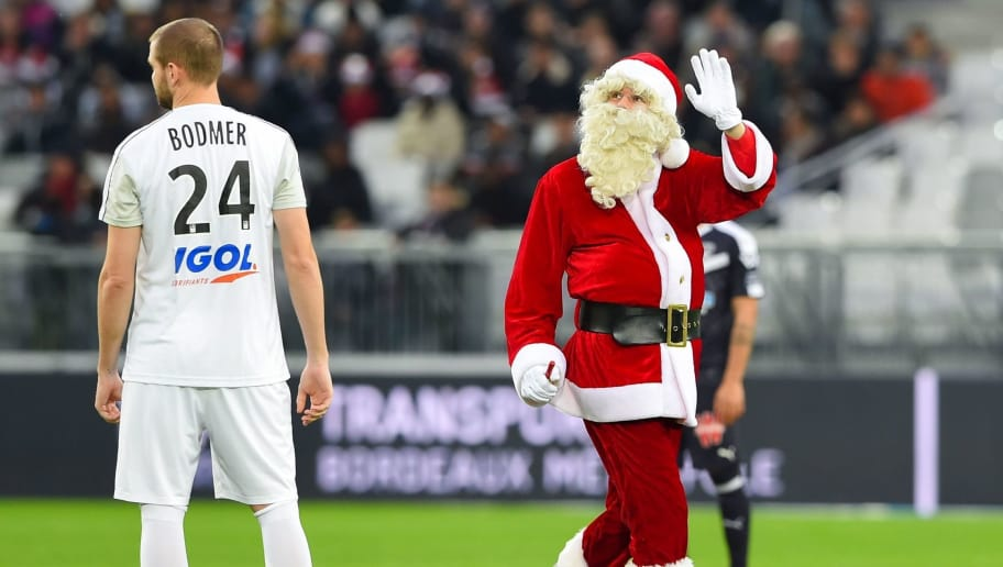 TOPSHOT - A man dressed as Santa Claus waves on the pitch prior to the French L1 football match between Bordeaux and Amiens on December 23, 2018 at the Matmut Atlantique stadium in Bordeaux, southwestern France. (Photo by NICOLAS TUCAT / AFP)        (Photo credit should read NICOLAS TUCAT/AFP/Getty Images)