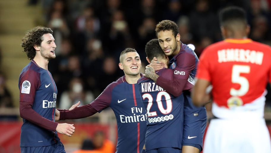 TOPSHOT - Paris Saint-Germain's Brazilian forward Neymar (2nd R) celebrates with Paris Saint-Germain's French defender Layvin Kurzawa (C), Paris Saint-Germain's Italian midfielder Marco Verratti (2nd L) and Paris Saint-Germain's French midfielder Adrien Rabiot (L) after scoring a penalty kick during the French L1 football match between Monaco and Paris Saint-Germain (PSG) at the Louis II stadium, in Monaco, on November 26, 2017. / AFP PHOTO / Valery HACHE        (Photo credit should read VALERY HACHE/AFP/Getty Images)