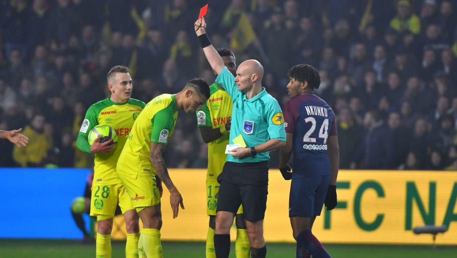 TOPSHOT - Nantes' Brazilian defender Diego Carlos (C) receives a red card from French referee Tony Chapron during the French L1 football match between Nantes and Paris Saint-Germain (Paris-SG) at the La Beaujoire stadium in Nantes, western France, on January 14, 2018.     / AFP PHOTO / LOIC VENANCE        (Photo credit should read LOIC VENANCE/AFP/Getty Images)