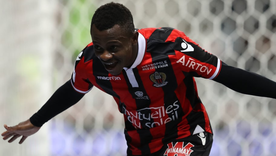 TOPSHOT - Nice's Ivorian midfielder Jean Michael Seri celebrates after scoring a goalduring the French L1 football match Nice (OGCN) vs Toulouse (TFC) on December 4, 2016 at the 'Allianz Riviera' stadium in Nice, southeastern France.  / AFP / VALERY HACHE        (Photo credit should read VALERY HACHE/AFP/Getty Images)