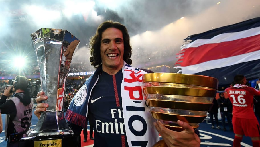 TOPSHOT - Paris Saint-Germain's Uruguayan forward Edinson Cavani celebrates after winning the French L1 title at the end of the French L1 football match Paris Saint-Germain (PSG) vs Rennes on May 12, 2018 at the Parc des Princes stadium in Paris. (Photo by FRANCK FIFE / AFP)        (Photo credit should read FRANCK FIFE/AFP/Getty Images)