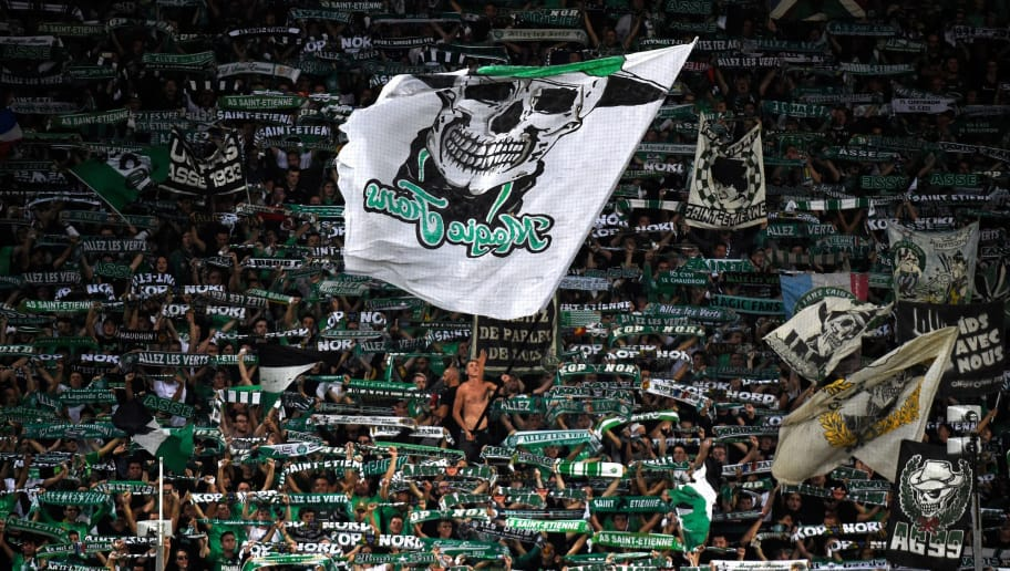 TOPSHOT - Saint-Etienne's supporters cheer during the French L1 football match Saint-Etienne (ASSE) vs Monaco (ASM) on September 28, 2018, at the Geoffroy Guichard Stadium in Saint-Etienne, central France. (Photo by JEAN-PHILIPPE KSIAZEK / AFP)        (Photo credit should read JEAN-PHILIPPE KSIAZEK/AFP/Getty Images)