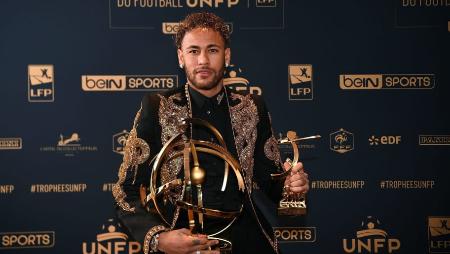 TOPSHOT - Paris Saint-Germain's Brazilian forward Neymar poses with his trophy after receiving the Best Ligue 1 Player award during a TV show on May 13, 2018 in Paris, as part of the 27th edition of the UNFP (French National Professional Football players Union) trophy ceremony. (Photo by FRANCK FIFE / AFP)        (Photo credit should read FRANCK FIFE/AFP/Getty Images)