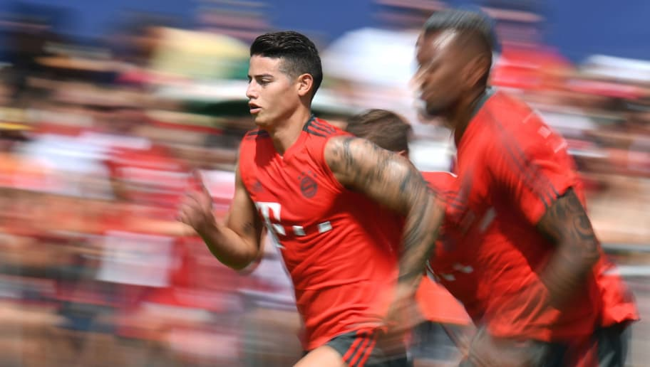 TOPSHOT - Bayern Munich's Colombian midfielder James Rodriguez (C) runs between teammates during a team trainings session of the German first division Bundesliga team FC Bayern Munich in the team trainings camp in Rottach-Egern, southern Germany, on August 6, 2018. (Photo by Christof STACHE / AFP)        (Photo credit should read CHRISTOF STACHE/AFP/Getty Images)