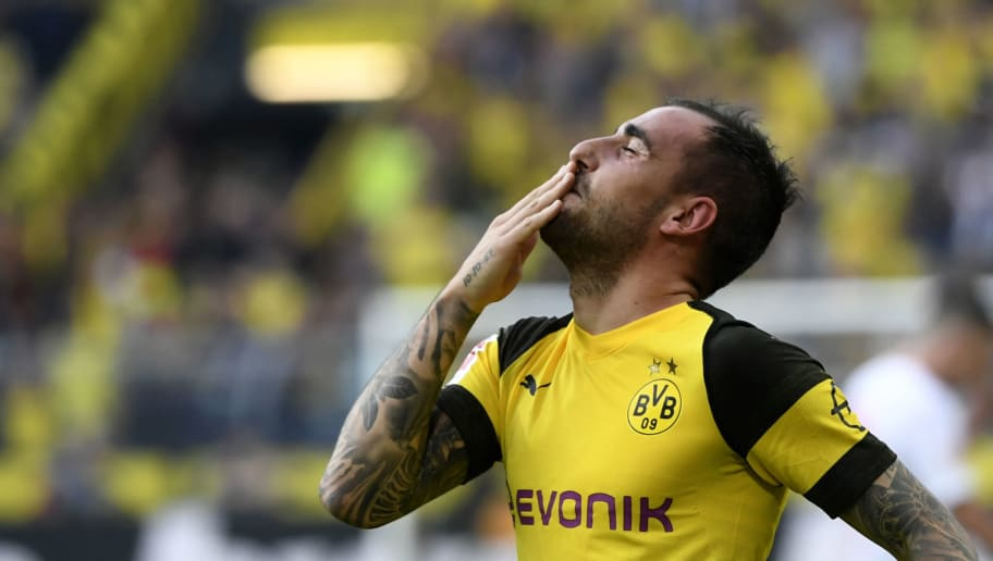 TOPSHOT - Dortmund's Spanish forward Paco Alcacer celebrates scoring the 4-3 against Augsburg during the German first division Bundesliga football match Borussia Dortmund vs FC Augsburg in Dortmund, western Germany, on October 6, 2018. (Photo by INA FASSBENDER / AFP) / RESTRICTIONS: DFL REGULATIONS PROHIBIT ANY USE OF PHOTOGRAPHS AS IMAGE SEQUENCES AND/OR QUASI-VIDEO        (Photo credit should read INA FASSBENDER/AFP/Getty Images)