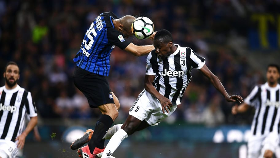 TOPSHOT - Inter Milan's defender Joao Miranda de Souza Filho from Brazil jumps for the ball with Juventus' midfielder Blaise Matuidi from France (R) during the Italian Serie A football match Inter Milan Vs Juventus on April 28, 2018 at the 'San Siro Stadium' in Milan. (Photo by MARCO BERTORELLO / AFP)        (Photo credit should read MARCO BERTORELLO/AFP/Getty Images)