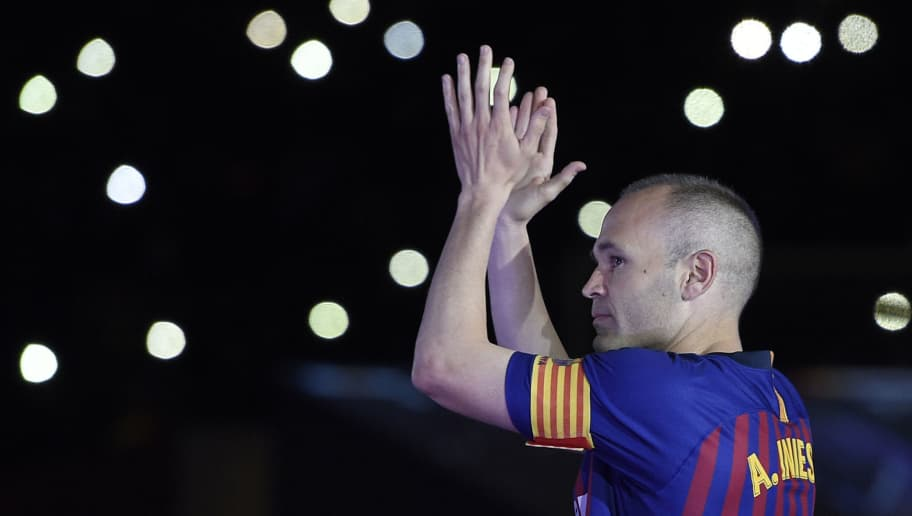 TOPSHOT - Barcelona's Spanish midfielder Andres Iniesta acknowledges fans during a tribute at the end of the Spanish league football match between FC Barcelona and Real Sociedad at the Camp Nou stadium in Barcelona on May 20, 2018. - Iniesta, who joined Barcelona's academy 22 years ago, played his final game for the club. (Photo by LLUIS GENE / AFP)        (Photo credit should read LLUIS GENE/AFP/Getty Images)