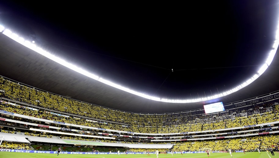 TOPSHOT - Fans of America cheer during their Clausura Mexican Tournament soccer match at the Azteca stadium in Mexico City on October 15, 2016. / AFP / ALFREDO ESTRELLA        (Photo credit should read ALFREDO ESTRELLA/AFP/Getty Images)