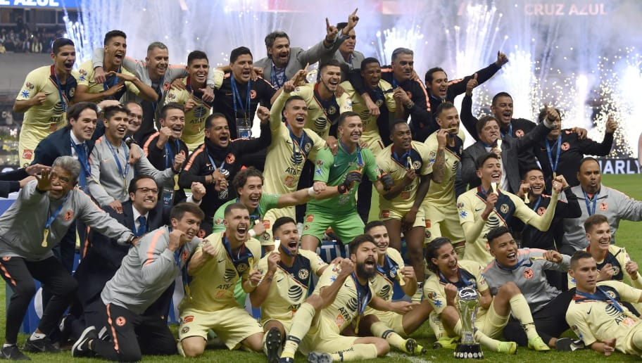 TOPSHOT - America's players celebrate after defeating Cruz Azul to win the Mexican Apertura Tournament football final at the Azteca stadium in Mexico City, on December 16, 2018. (Photo by RODRIGO ARANGUA / AFP)        (Photo credit should read RODRIGO ARANGUA/AFP/Getty Images)