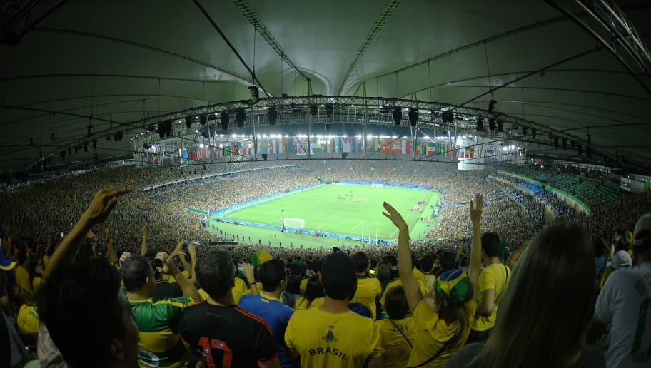 TOPSHOT - Brazil's supporters celbrate after winning the penalty shoot-out of the Rio 2016 Olympic Games men's football gold medal match between Brazil and Germany at the Maracana stadium in Rio de Janeiro on August 20, 2016.  / AFP / Johannes EISELE        (Photo credit should read JOHANNES EISELE/AFP/Getty Images)