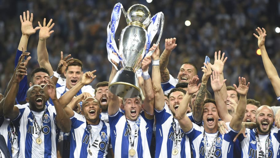 TOPSHOT - Porto's players celebrate with the trophy after winning the league title following the Portuguese league football match between FC Porto and CD Feirense at the Dragao stadium in Porto on May 6, 2018. (Photo by MIGUEL RIOPA / AFP)        (Photo credit should read MIGUEL RIOPA/AFP/Getty Images)