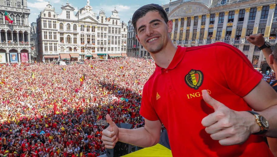 TOPSHOT - Belgium's goalkeeper Thibaut Courtois celebrates at the Grand Place/Grote Markt in Brussels city center, as Belgian national football team Red Devils arrive to celebrate with supporters at the balcony of the city hall after reaching the semi-finals and winning the bronze medal at the Russia 2018 World Cup on July 15, 2018. (Photo by Yves HERMAN / BELGA / AFP) / Belgium OUT        (Photo credit should read YVES HERMAN/AFP/Getty Images)