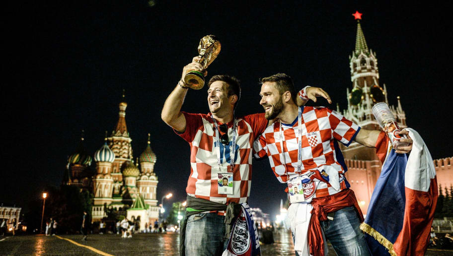 TOPSHOT - Croatia's supporters celebrate their team victory at Red Square in Moscow early on July 12, 2018 after the Russia 2018 World Cup football tournament semi-final match between England and Croatia. (Photo by Konstantin CHALABOV / AFP)        (Photo credit should read KONSTANTIN CHALABOV/AFP/Getty Images)