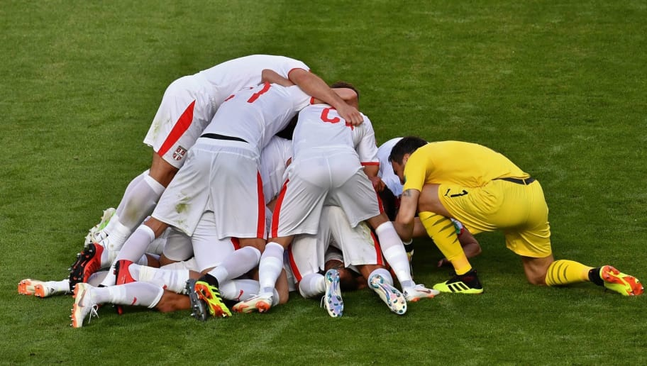 TOPSHOT - Serbia's players celebrate their opening goal during the Russia 2018 World Cup Group E football match between Costa Rica and Serbia at the Samara Arena in Samara on June 17, 2018. (Photo by Fabrice COFFRINI / AFP) / RESTRICTED TO EDITORIAL USE - NO MOBILE PUSH ALERTS/DOWNLOADS        (Photo credit should read FABRICE COFFRINI/AFP/Getty Images)