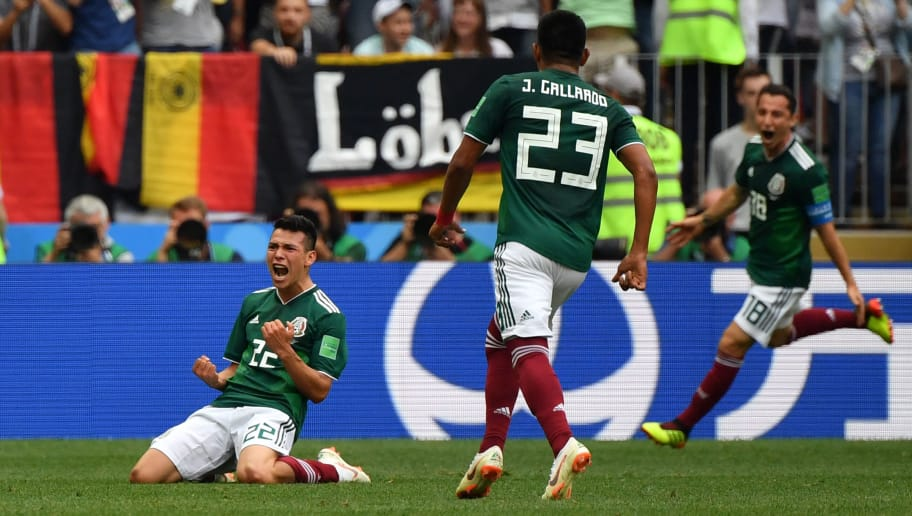 TOPSHOT - Mexico's forward Hirving Lozano celebrates after scoring their first goal during the Russia 2018 World Cup Group F football match between Germany and Mexico at the Luzhniki Stadium in Moscow on June 17, 2018. (Photo by Yuri CORTEZ / AFP) / RESTRICTED TO EDITORIAL USE - NO MOBILE PUSH ALERTS/DOWNLOADS        (Photo credit should read YURI CORTEZ/AFP/Getty Images)