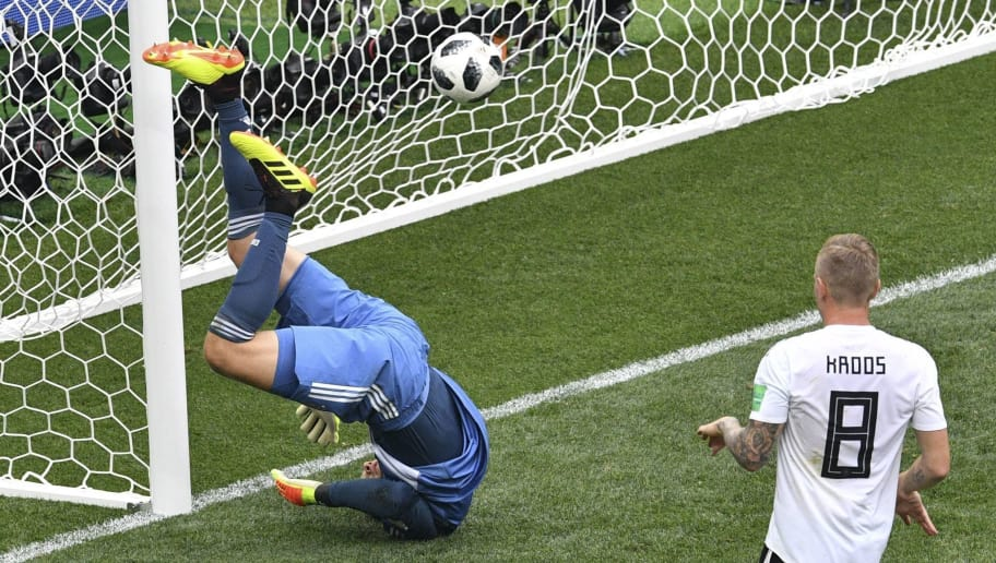 TOPSHOT - Germany's goalkeeper Manuel Neuer (L) concedes a goal during the Russia 2018 World Cup Group F football match between Germany and Mexico at the Luzhniki Stadium in Moscow on June 17, 2018. (Photo by Mladen ANTONOV / AFP) / RESTRICTED TO EDITORIAL USE - NO MOBILE PUSH ALERTS/DOWNLOADS        (Photo credit should read MLADEN ANTONOV/AFP/Getty Images)