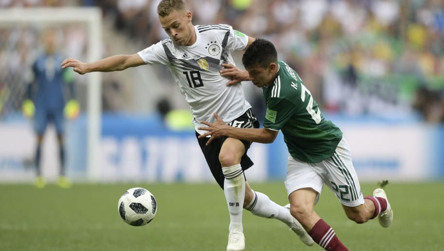 TOPSHOT - Germany's defender Joshua Kimmich (L) vies for the ball with Mexico's forward Hirving Lozano  during the Russia 2018 World Cup Group F football match between Germany and Mexico at the Luzhniki Stadium in Moscow on June 17, 2018. (Photo by Juan Mabromata / AFP) / RESTRICTED TO EDITORIAL USE - NO MOBILE PUSH ALERTS/DOWNLOADS        (Photo credit should read JUAN MABROMATA/AFP/Getty Images)