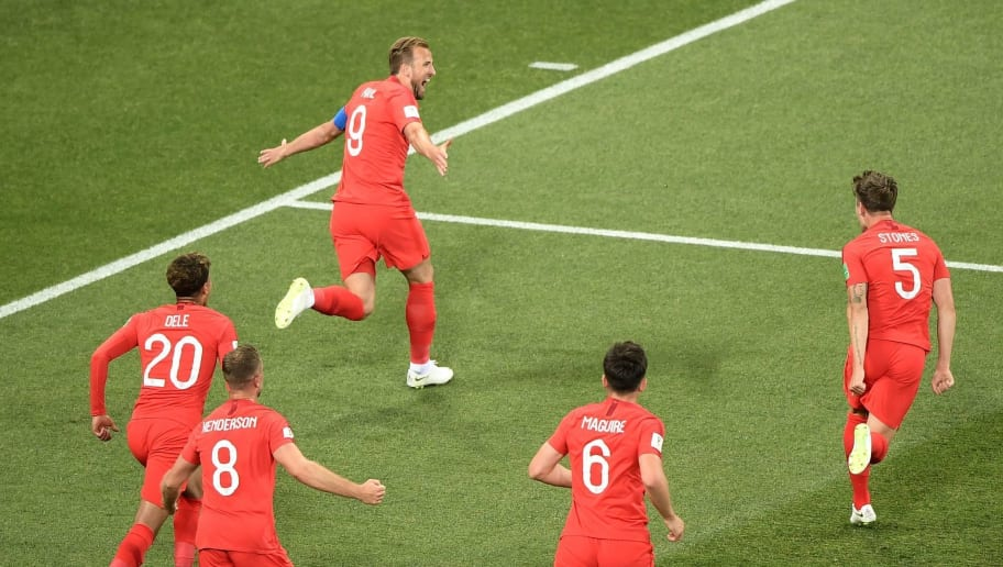 TOPSHOT - England's forward Harry Kane (up) celebrates after scoring his first goal  during the Russia 2018 World Cup Group G football match between Tunisia and England at the Volgograd Arena in Volgograd on June 18, 2018. (Photo by NICOLAS ASFOURI / AFP) / RESTRICTED TO EDITORIAL USE - NO MOBILE PUSH ALERTS/DOWNLOADS        (Photo credit should read NICOLAS ASFOURI/AFP/Getty Images)