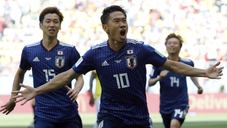 TOPSHOT - Japan's midfielder Shinji Kagawa celebrates with teammates after scoring a penalty during the Russia 2018 World Cup Group H football match between Colombia and Japan at the Mordovia Arena in Saransk on June 19, 2018. (Photo by Jack GUEZ / AFP) / RESTRICTED TO EDITORIAL USE - NO MOBILE PUSH ALERTS/DOWNLOADS        (Photo credit should read JACK GUEZ/AFP/Getty Images)