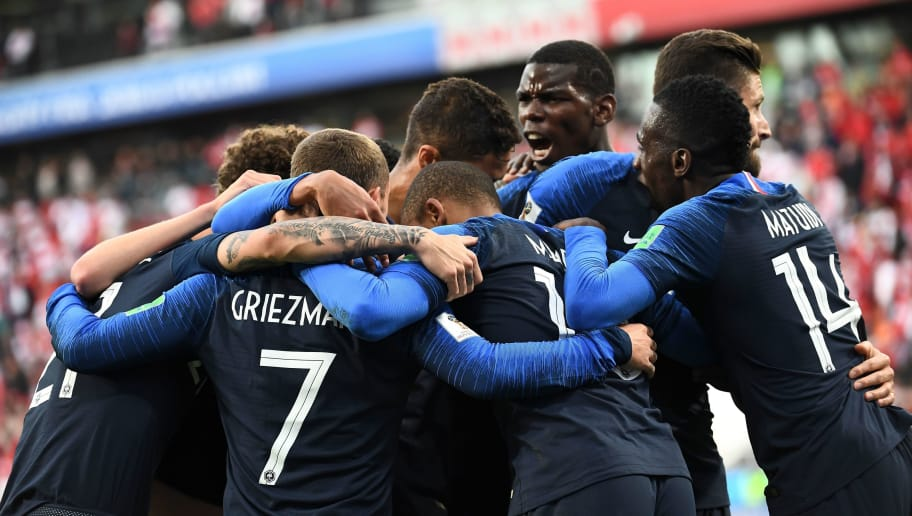 TOPSHOT - France's forward Kylian Mbappe (C) celebrates scoring the opening goal with his teammates during the Russia 2018 World Cup Group C football match between France and Peru at the Ekaterinburg Arena in Ekaterinburg on June 21, 2018. (Photo by Anne-Christine POUJOULAT / AFP) / RESTRICTED TO EDITORIAL USE - NO MOBILE PUSH ALERTS/DOWNLOADS        (Photo credit should read ANNE-CHRISTINE POUJOULAT/AFP/Getty Images)