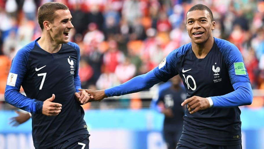 TOPSHOT - France's forward Kylian Mbappe (R) celebrates scoring the opening goal with his teammate forward Antoine Griezmann during the Russia 2018 World Cup Group C football match between France and Peru at the Ekaterinburg Arena in Ekaterinburg on June 21, 2018. (Photo by Anne-Christine POUJOULAT / AFP) / RESTRICTED TO EDITORIAL USE - NO MOBILE PUSH ALERTS/DOWNLOADS        (Photo credit should read ANNE-CHRISTINE POUJOULAT/AFP/Getty Images)