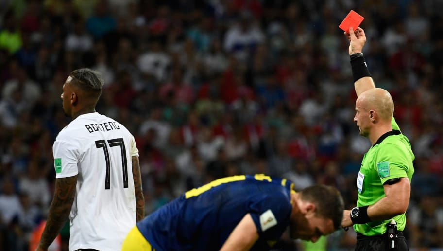 TOPSHOT - Polish referee Szymon Marciniak (R) presents Germany's defender Jerome Boateng (L) with a red card during the Russia 2018 World Cup Group F football match between Germany and Sweden at the Fisht Stadium in Sochi on June 23, 2018. (Photo by Jonathan NACKSTRAND / AFP) / RESTRICTED TO EDITORIAL USE - NO MOBILE PUSH ALERTS/DOWNLOADS        (Photo credit should read JONATHAN NACKSTRAND/AFP/Getty Images)
