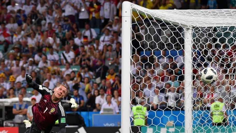 TOPSHOT - Sweden's goalkeeper Robin Olsen watchs Germany's midfielder Toni Kroos' free kick go in during the Russia 2018 World Cup Group F football match between Germany and Sweden at the Fisht Stadium in Sochi on June 23, 2018. (Photo by Nelson Almeida / AFP) / RESTRICTED TO EDITORIAL USE - NO MOBILE PUSH ALERTS/DOWNLOADS        (Photo credit should read NELSON ALMEIDA/AFP/Getty Images)