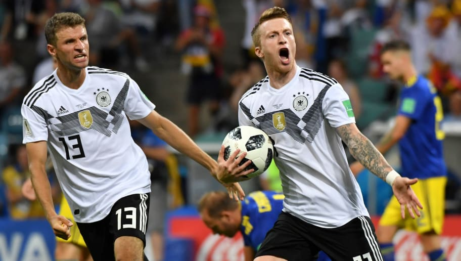 TOPSHOT - Germany's forward Marco Reus celebrates scoring the 1-1 goal with Germany's forward Thomas Mueller (L) during the Russia 2018 World Cup Group F football match between Germany and Sweden at the Fisht Stadium in Sochi on June 23, 2018. (Photo by Nelson Almeida / AFP) / RESTRICTED TO EDITORIAL USE - NO MOBILE PUSH ALERTS/DOWNLOADS        (Photo credit should read NELSON ALMEIDA/AFP/Getty Images)