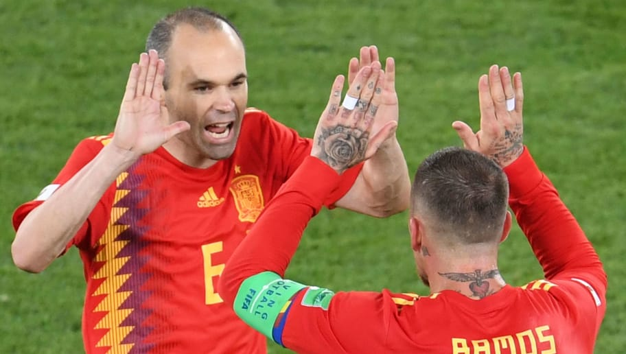 TOPSHOT - Spain's midfielder Andres Iniesta (L) and Spain's defender Sergio Ramos celebrate their second goal during the Russia 2018 World Cup Group B football match between Spain and Morocco at the Kaliningrad Stadium in Kaliningrad on June 25, 2018. (Photo by OZAN KOSE / AFP) / RESTRICTED TO EDITORIAL USE - NO MOBILE PUSH ALERTS/DOWNLOADS        (Photo credit should read OZAN KOSE/AFP/Getty Images)
