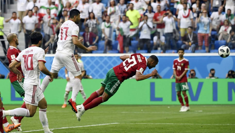 TOPSHOT - Morocco's forward Aziz Bouhaddouz scores an own goal during the Russia 2018 World Cup Group B football match between Morocco and Iran at the Saint Petersburg Stadium in Saint Petersburg on June 15, 2018. (Photo by CHRISTOPHE SIMON / AFP) / RESTRICTED TO EDITORIAL USE - NO MOBILE PUSH ALERTS/DOWNLOADS        (Photo credit should read CHRISTOPHE SIMON/AFP/Getty Images)