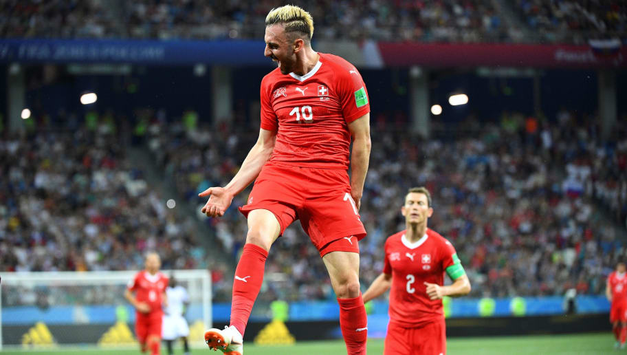 TOPSHOT - Switzerland's forward Josip Drmic (L) celebrates  after scoring his team's second goal  during the Russia 2018 World Cup Group E football match between Switzerland and Costa Rica at the Nizhny Novgorod Stadium in Nizhny Novgorod on June 27, 2018. (Photo by Johannes EISELE / AFP) / RESTRICTED TO EDITORIAL USE - NO MOBILE PUSH ALERTS/DOWNLOADS        (Photo credit should read JOHANNES EISELE/AFP/Getty Images)