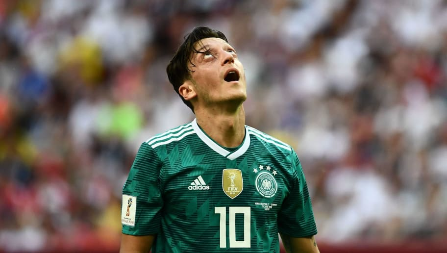 TOPSHOT - Germany's midfielder Mesut Ozil reacts during the Russia 2018 World Cup Group F football match between South Korea and Germany at the Kazan Arena in Kazan on June 27, 2018. (Photo by Jewel SAMAD / AFP) / RESTRICTED TO EDITORIAL USE - NO MOBILE PUSH ALERTS/DOWNLOADS        (Photo credit should read JEWEL SAMAD/AFP/Getty Images)