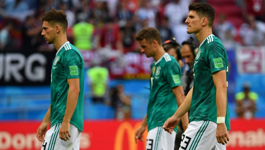 TOPSHOT - Germany's team players react at the end of the Russia 2018 World Cup Group F football match between South Korea and Germany at the Kazan Arena in Kazan on June 27, 2018. (Photo by SAEED KHAN / AFP) / RESTRICTED TO EDITORIAL USE - NO MOBILE PUSH ALERTS/DOWNLOADS        (Photo credit should read SAEED KHAN/AFP/Getty Images)