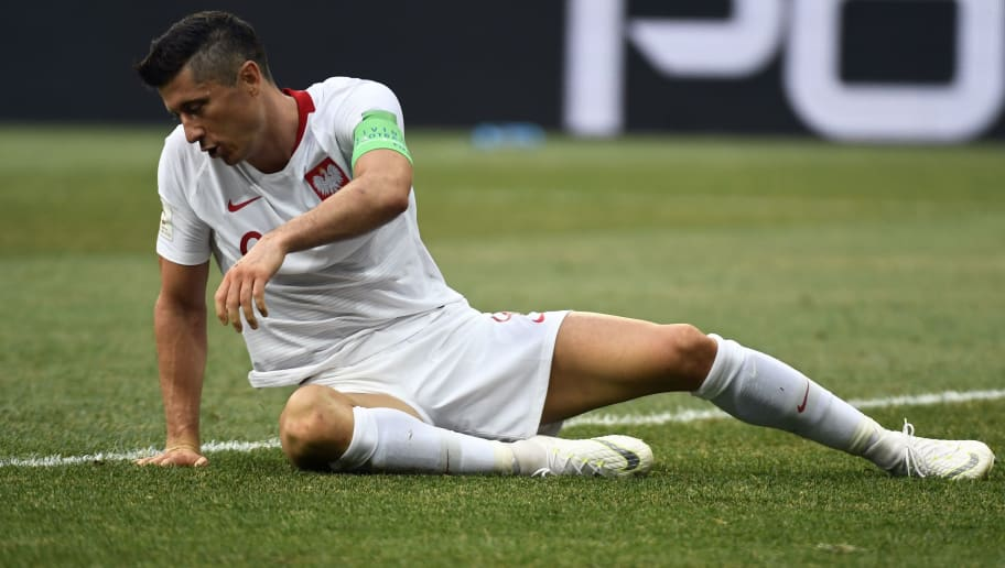 TOPSHOT - Poland's forward Robert Lewandowski lies on the pitch during the Russia 2018 World Cup Group H football match between Japan and Poland at the Volgograd Arena in Volgograd on June 28, 2018. (Photo by Philippe DESMAZES / AFP) / RESTRICTED TO EDITORIAL USE - NO MOBILE PUSH ALERTS/DOWNLOADS        (Photo credit should read PHILIPPE DESMAZES/AFP/Getty Images)