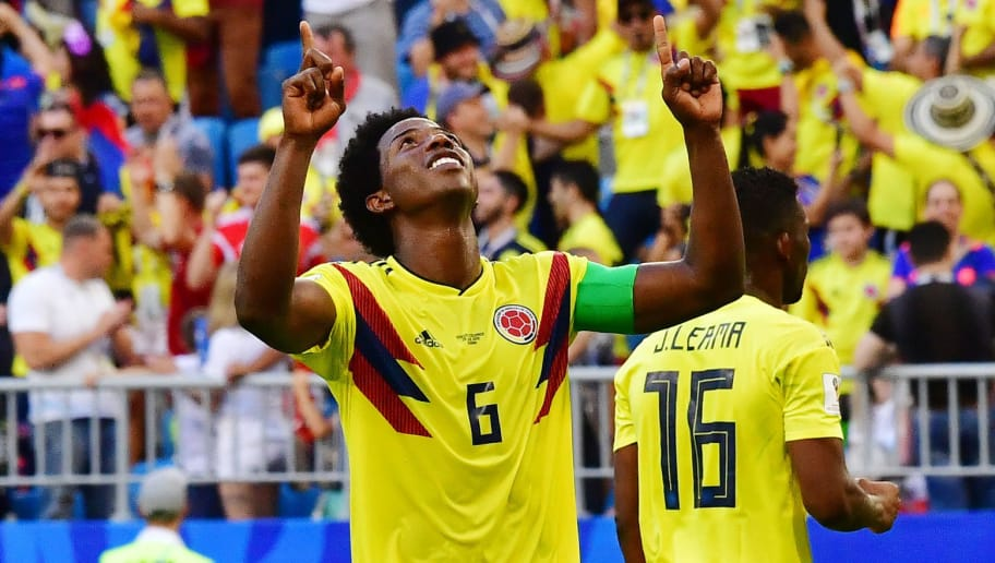 TOPSHOT - Colombia's midfielder Carlos Sanchez (C) celebrates at the end of the Russia 2018 World Cup Group H football match between Senegal and Colombia at the Samara Arena in Samara on June 28, 2018. (Photo by Luis Acosta / AFP) / RESTRICTED TO EDITORIAL USE - NO MOBILE PUSH ALERTS/DOWNLOADS        (Photo credit should read LUIS ACOSTA/AFP/Getty Images)