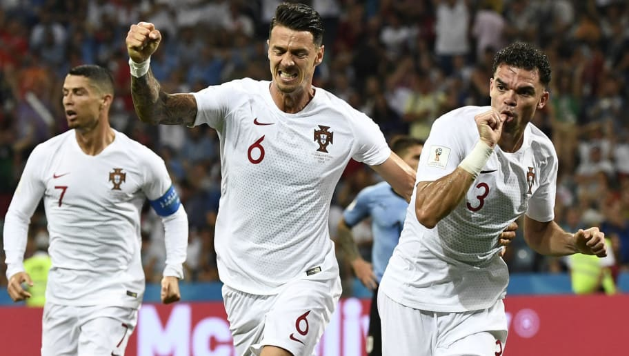 TOPSHOT - Portugal's defender Pepe (R) celebrates with Portugal's defender Jose Fonte (C) after scoring the equalizer during the Russia 2018 World Cup round of 16 football match between Uruguay and Portugal at the Fisht Stadium in Sochi on June 30, 2018. (Photo by Jonathan NACKSTRAND / AFP) / RESTRICTED TO EDITORIAL USE - NO MOBILE PUSH ALERTS/DOWNLOADS        (Photo credit should read JONATHAN NACKSTRAND/AFP/Getty Images)